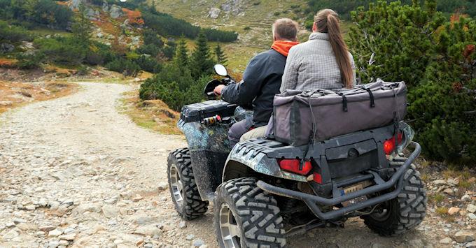 couple on atv trail